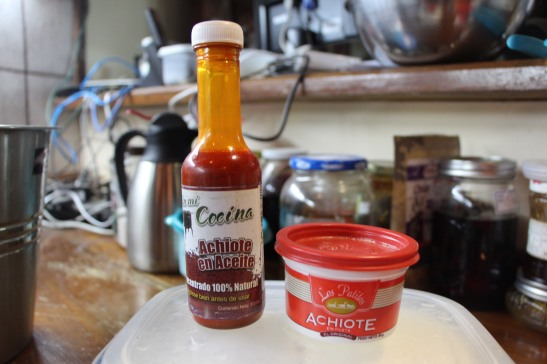 Achiote. sort of like saffron shoe polish when you look at it but it tastes wonderful.